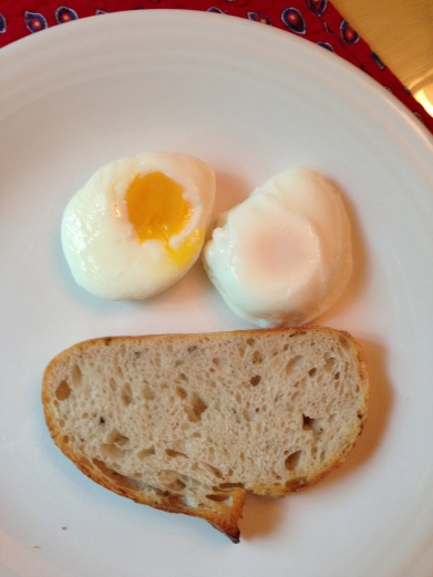 i have been having poached eggs lately with a slice of artisan garlic bread. the eggs have been quite expressive lately. today, they were decidely confused.