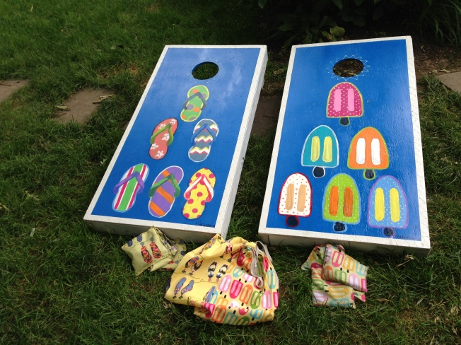 Corn holes! Summer time's favorite game! I painted the designs based on the patterns I found for the bags.