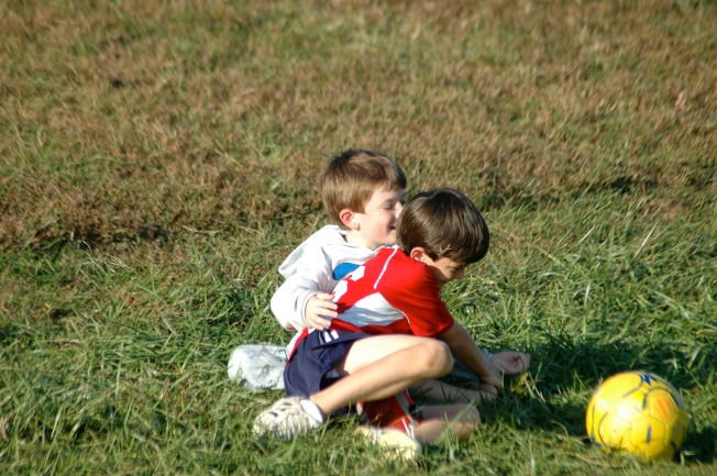 i seldom include a picture of my kids in my blog; but this one's quite old and it's so cute of them on the ground an playing i couldn't resist.