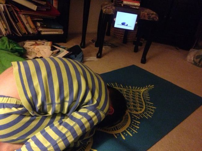 Thing 3 and his mat and his yoga app.
