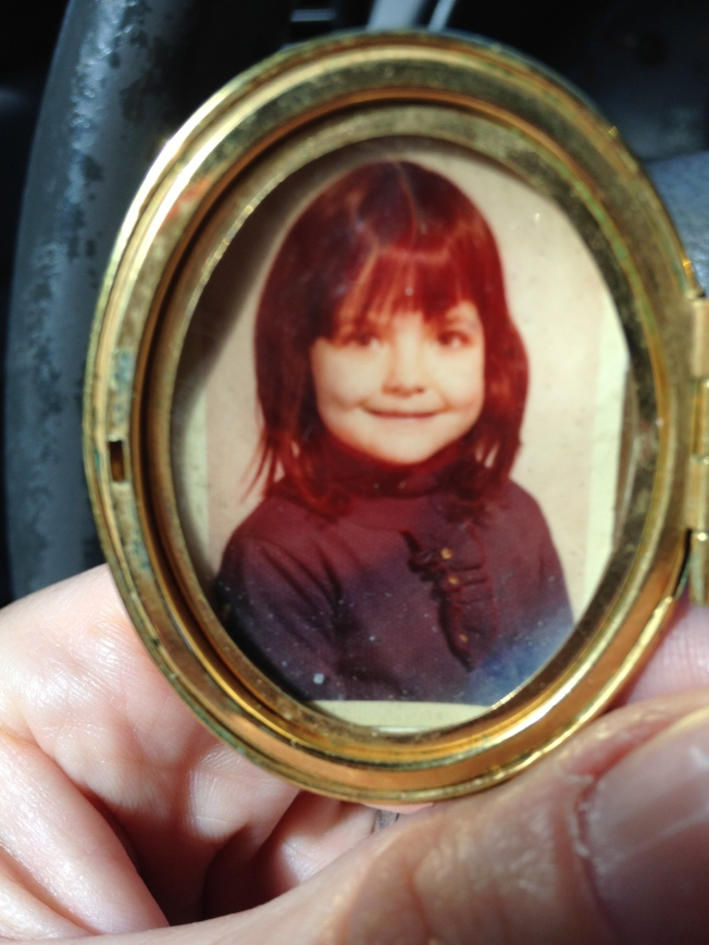 I took this picture in the car, at a red light about three miles from the train station. I was five in this image; about the time in my life when I can remember mostly sadnesses and feeling alone.  I cut my own bangs.
